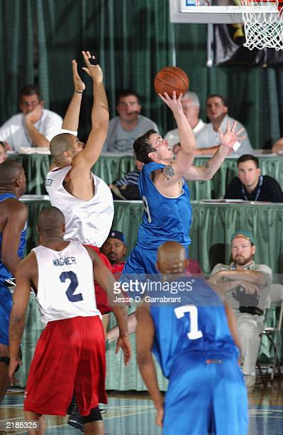 Chris Herren of the Dallas Mavericks goes to the basket past Carlos Boozer of the Cleveland Cavaliers during the Reebok Pro Summer League on July 17...