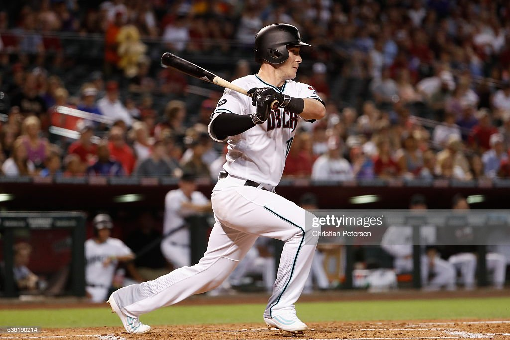 <a gi-track='captionPersonalityLinkClicked' href=/galleries/search?phrase=Chris+Herrmann+-+Baseball+Player&family=editorial&specificpeople=7553012 ng-click='$event.stopPropagation()'>Chris Herrmann</a> #10 of the Arizona Diamondbacks hits a RBI on a fielder's choice during the first inning of the MLB game against the Arizona Diamondbacks at Chase Field on May 31, 2016 in Phoenix, Arizona.