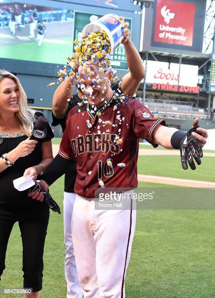 Chris Herrmann of the Arizona Diamondbacks is showered with bubble gum after hitting the gamewinning solo home run against the New York Mets in the...
