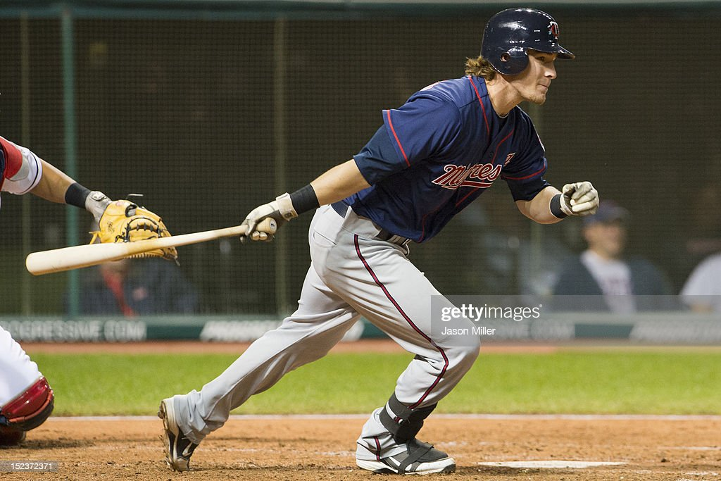 Chris Herrmann #23 of the Minnesota Twins hits an RBI single during the fifth inning against the Cleveland Indians at Progressive Field on September 19, 2012 in Cleveland, Ohio.