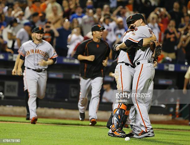 Chris Heston of the San Francisco Giants celebrates his no hitter with Buster Posey against the New York Mets after their game at Citi Field on June...
