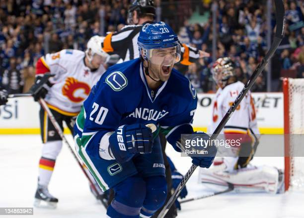 Chris Higgins of the Vancouver Canucks celebrates after scoring on goalie Henrik Karlsson of the Calgary Flames during the second period in NHL...