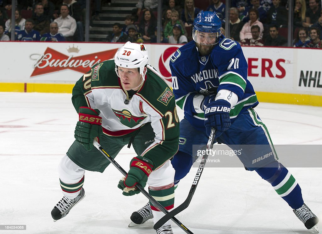Chris Higgins #20 of the Vancouver Canucks checks <a gi-track='captionPersonalityLinkClicked' href=/galleries/search?phrase=Ryan+Suter&family=editorial&specificpeople=583306 ng-click='$event.stopPropagation()'>Ryan Suter</a> #20 of the Minnesota Wild during their NHL game at Rogers Arena March 18, 2013 in Vancouver, British Columbia, Canada. Minnesota won 3-1.