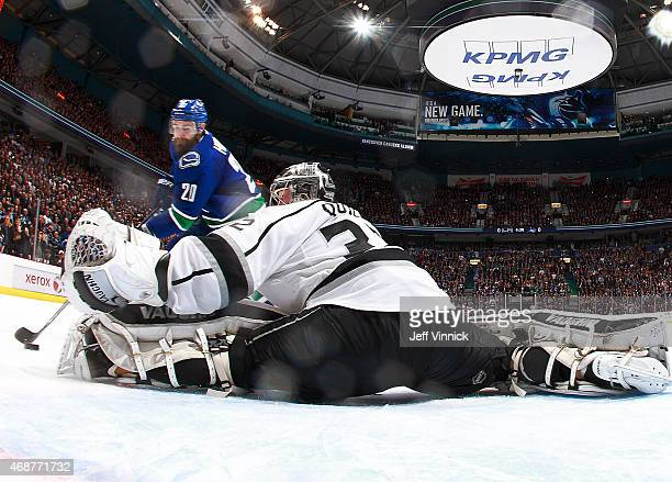 Chris Higgins of the Vancouver Canucks goes to his backhand for the shootout winning goal against Jonathan Quick of the Los Angeles Kings during...