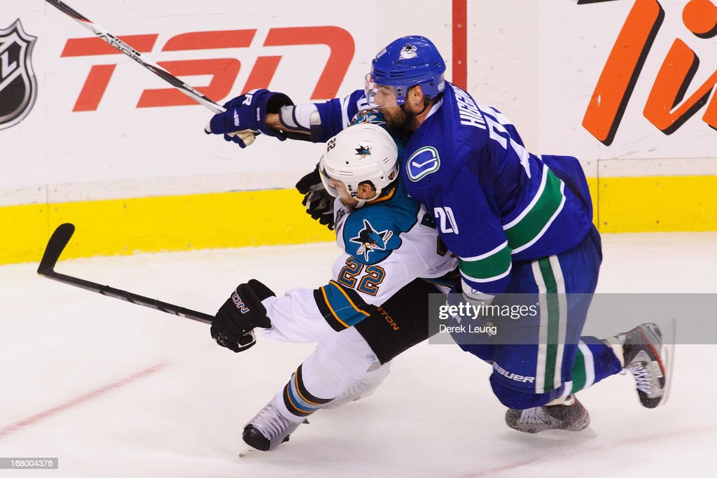 Chris Higgins #20 of the Vancouver Canucks rides the back of <a gi-track='captionPersonalityLinkClicked' href=/galleries/search?phrase=Dan+Boyle&family=editorial&specificpeople=201502 ng-click='$event.stopPropagation()'>Dan Boyle</a> #22 of the San Jose Sharks as they chase the puck into the corner in Game Two of the Western Conference Quarterfinals during the 2013 NHL Stanley Cup Playoffs at Rogers Arena on May 3, 2013 in Vancouver, British Columbia, Canada.