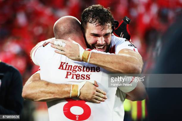 Chris Hill and Alex Walmsley of England celebrate after winning the 2017 Rugby League World Cup Semi Final match between Tonga and England at Mt...