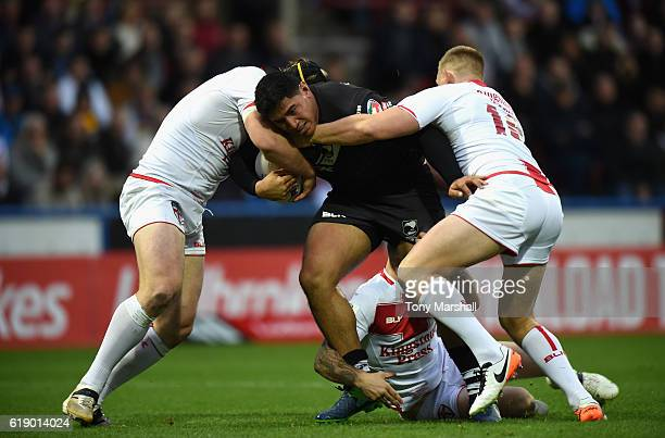 Chris Hill and Mike Cooper of England tackle Jason Taumalolo of New Zealand Kiwis during the Four Nations match between the England and New Zealand...