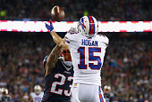 Chris Hogan of the Buffalo Bills attempts to catch a pass as he is defended by Patrick Chung of the New England Patriots at Gillette Stadium on...