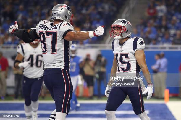 Chris Hogan of the New England Patriots celebrates a first quarter touchdown with Rob Gronkowski while playing the Detroit Lions during a preseason...
