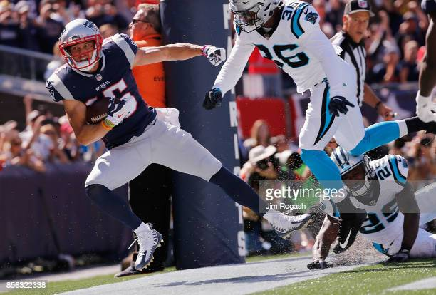 Chris Hogan of the New England Patriots goes out of bounds after making a 2yard touchdown reception during the second quarter against the Carolina...