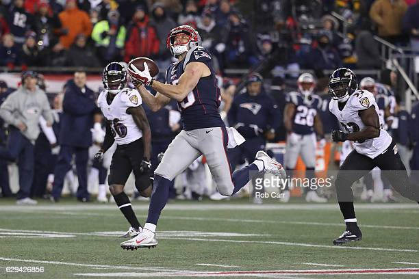 Chris Hogan of the New England Patriots makes a 79yard touchdown reception during the fourth quarter against the Baltimore Ravens at Gillette Stadium...