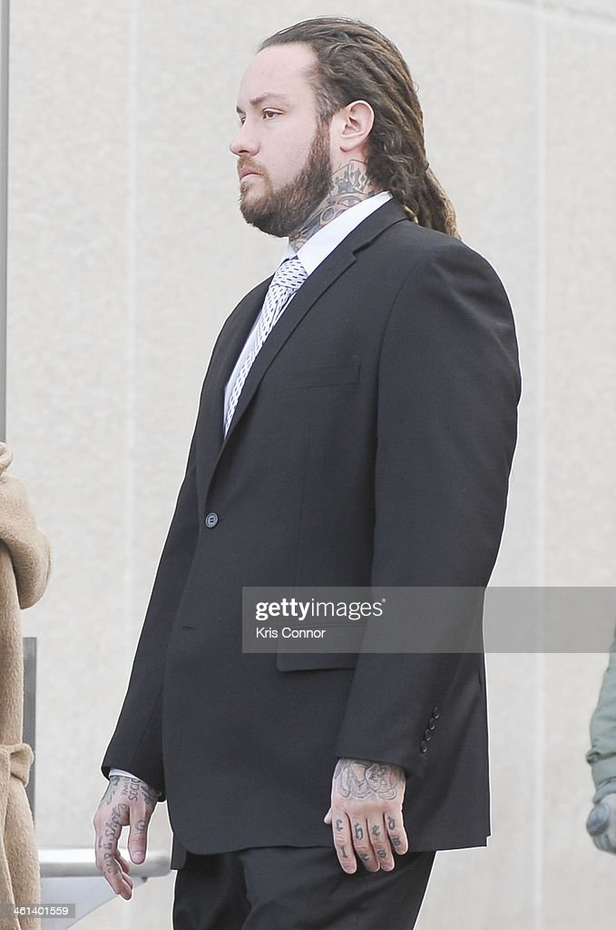 Chris Hollosy leaves court where his attorneys rejected a plea deal that would have found him and singer Chris Brown guilty of simple assault on January 8, 2014 in Washington, DC. Hollosy and Brown face misdemeanor assault charges for allegedly punching a man in the face in October 2013.