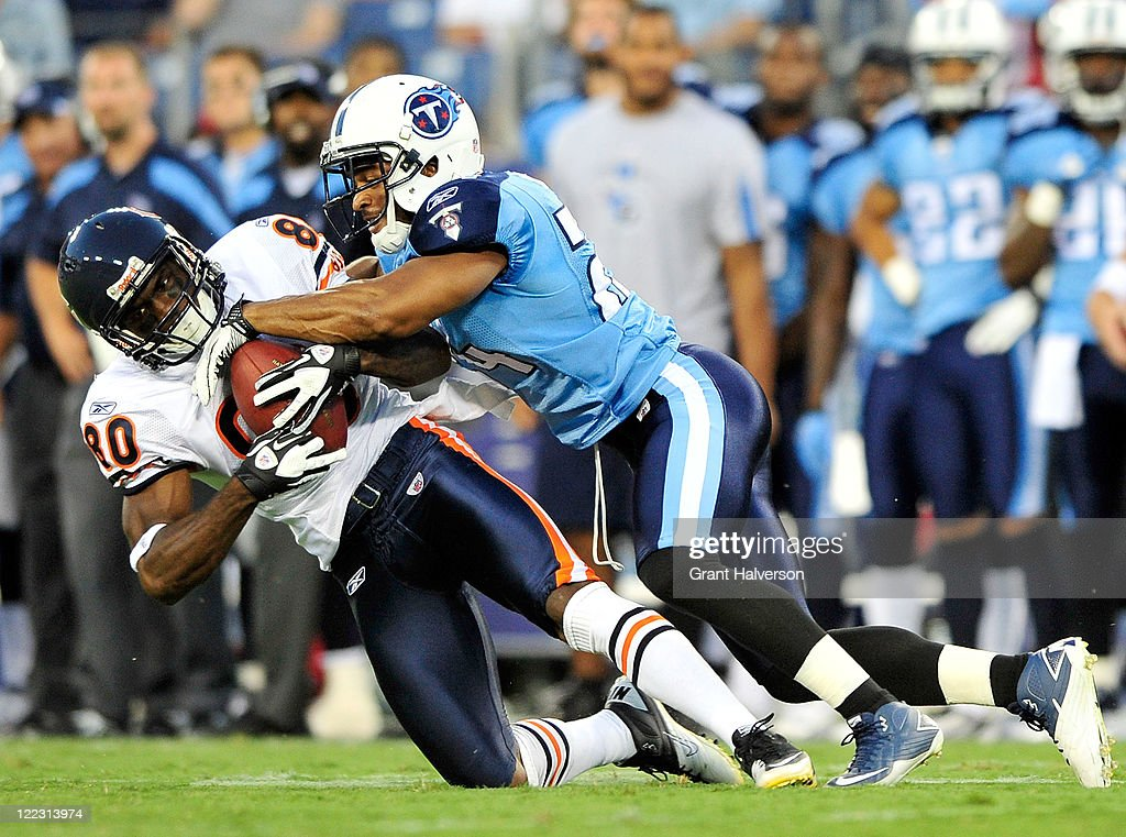 <a gi-track='captionPersonalityLinkClicked' href=/galleries/search?phrase=Chris+Hope&family=editorial&specificpeople=210788 ng-click='$event.stopPropagation()'>Chris Hope</a> #24 of the Tennessee Titans tackles Earl Bennett #80 of the Chicago Bears during a preseason game at LP Field on August 27, 2011 in Nashville, Tennessee.