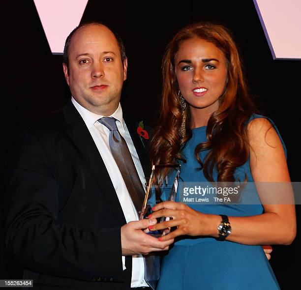 Chris Hornbuckle of Vauxhall presents Alex Greenwood of Everton Ladies U19's with the 'Young player of the Year' award during the FA Women's Awards...