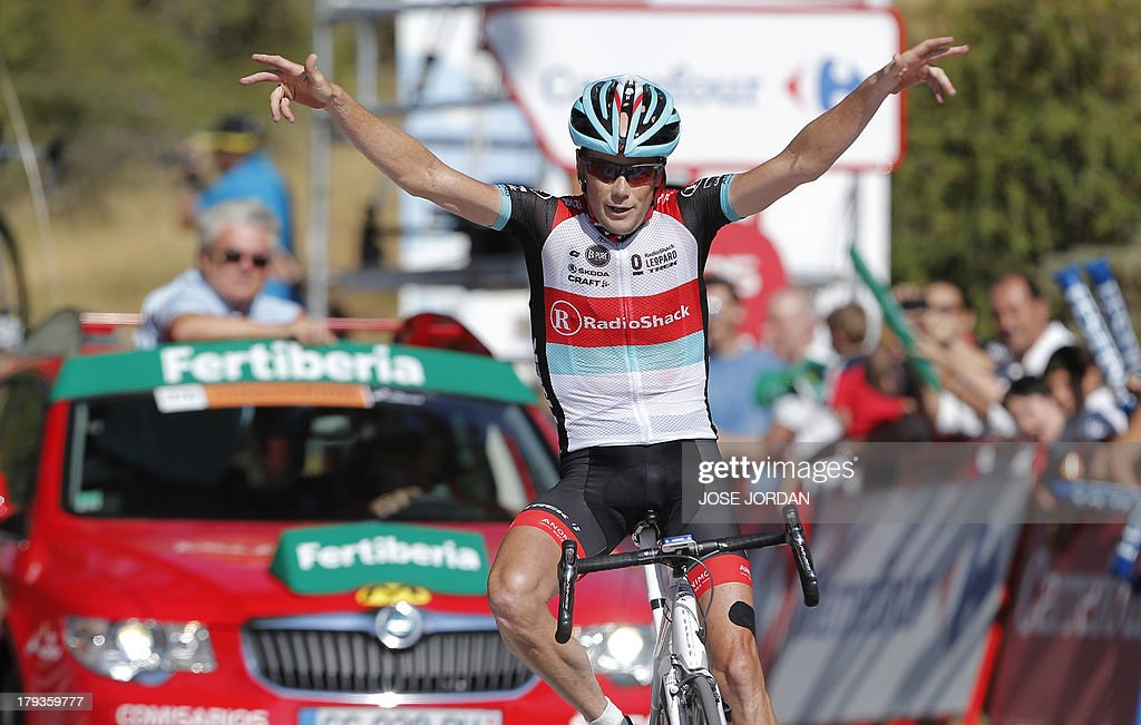 US Chris Horner (RadioShack) celebrates winning as he crosses the finish line on September 2, 2013 after the tenth stage of the 68th edition of 'La Vuelta' Tour of Spain, a 186.8 km route between Torredelcampo and Guejar Sierra.