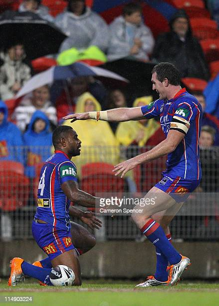 Chris Houston of the Knights congratulates Wes Naiqama after scoring a try during the round 12 NRL match between the Newcastle Knights and the...