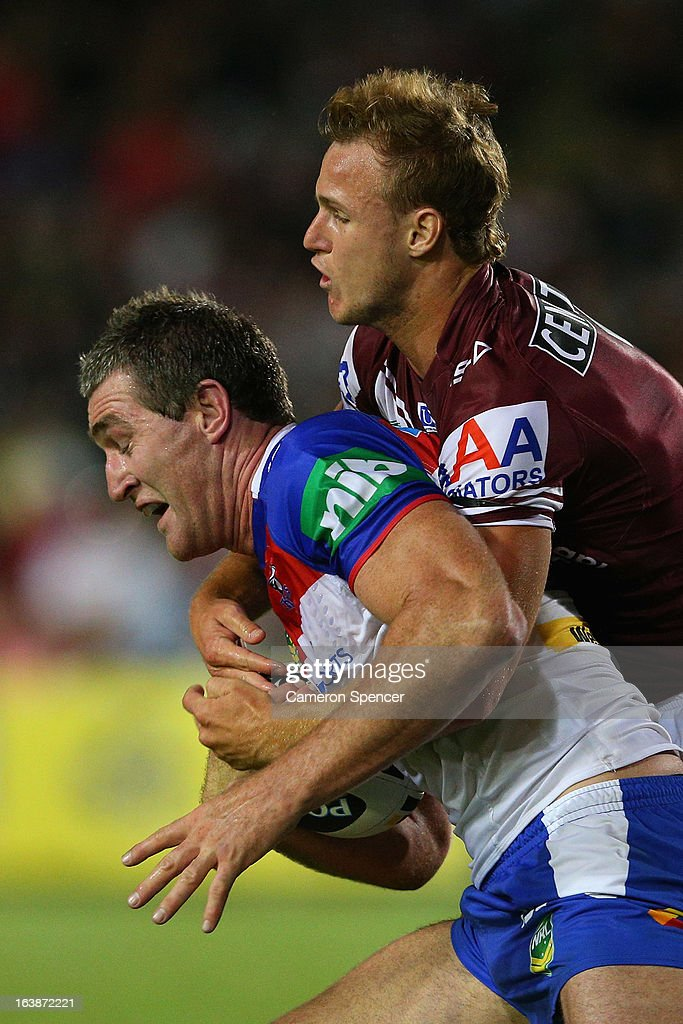 Chris Houston of the Knights is tackled by Daly Cherry-Evans of the Sea Eagles during the round two NRL match between the Manly Sea Eagles and the Newcastle Knights at Brookvale Oval on March 17, 2013 in Sydney, Australia.