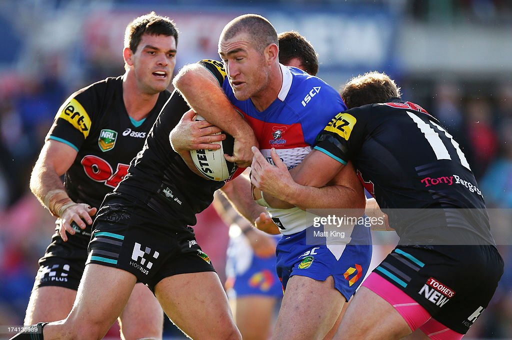 Chris Houston of the Knights is tackled during the round 19 NRL match between the Penrtih Panthers and the Newcastle Knights at Centrebet Stadium on July 21, 2013 in Penrith, Australia.