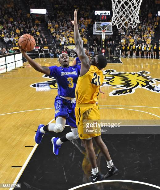 Chris Howell of the South Dakota State Jackrabbits drives to the basket against Darral Willis Jr #21 of the Wichita State Shockers during the first...