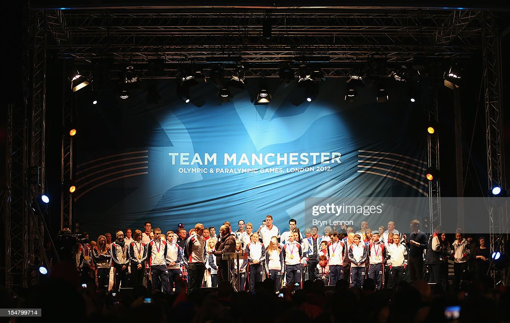 <a gi-track='captionPersonalityLinkClicked' href=/galleries/search?phrase=Chris+Hoy&family=editorial&specificpeople=171259 ng-click='$event.stopPropagation()'>Chris Hoy</a> is interviewed as Manchester Olympian and Paralympian Athletes gather on stage at a team Manchester event at Albert Square on October 26, 2012 in Manchester, England.