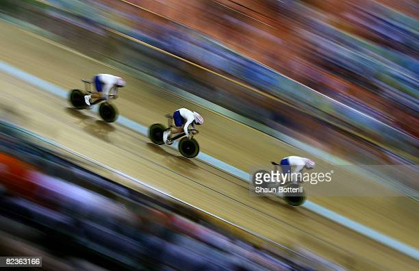 Chris Hoy Jason Kenny and Jamie Staff of Great Britain race on their way to gold against France during the men's team sprint track cycling event at...