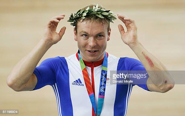 Chris Hoy of Great Britain adjusts his head wreath during the singing of the national anthem after setting a new Olympic record and winning the gold...