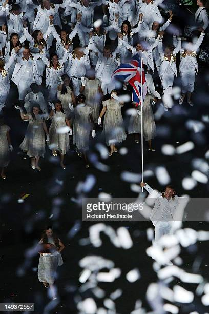 Chris Hoy of Great Britain carries his country's flag during the Opening Ceremony of the London 2012 Olympic Games at the Olympic Stadium on July 27...