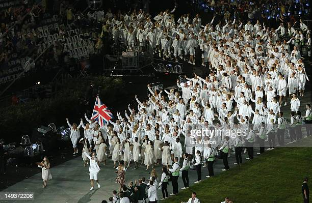 Chris Hoy of Great Britain Olympic carries his country's flag during the Opening Ceremony of the London 2012 Olympic Games at the Olympic Stadium on...