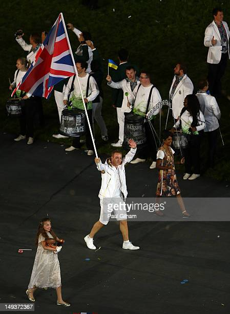 Chris Hoy of the Great Britain Olympic cycling team carries his country's flag during the Opening Ceremony of the London 2012 Olympic Games at the...