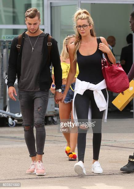 Chris Hughes and Olivia Attwood from Love Island arrive at Stanstead airport on July 25 2017 in London England