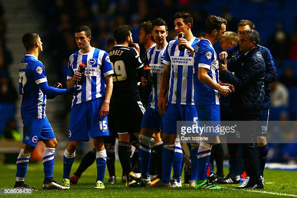 Chris Hughton manager of Brighton and Hove Albion speaks with his players during the Sky Bet Championship match between Brighton and Hove Albion and...