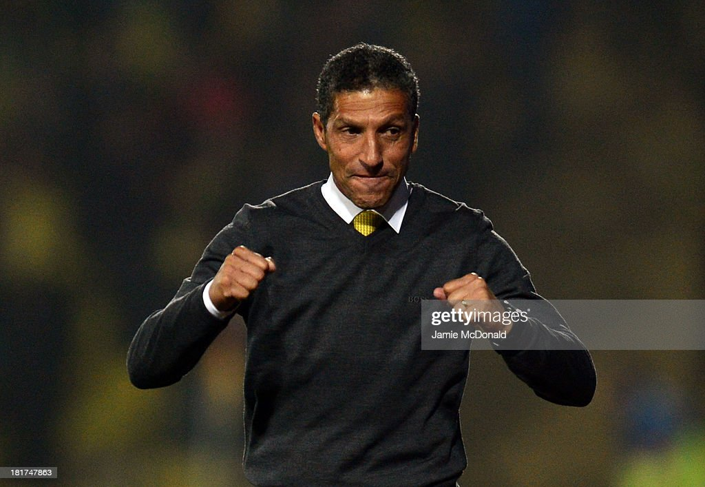 <a gi-track='captionPersonalityLinkClicked' href=/galleries/search?phrase=Chris+Hughton&family=editorial&specificpeople=646349 ng-click='$event.stopPropagation()'>Chris Hughton</a> manager of Norwich City celebrates during the Capital One Cup Third Round match between Watford and Norwich City at Vicarage Road on September 24, 2013 in Watford, England.