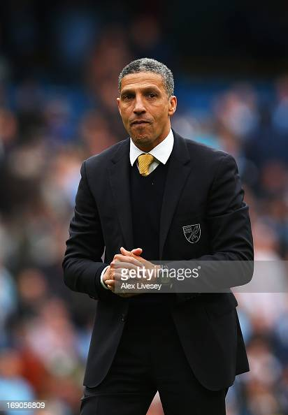 Chris Hughton the Norwich City manager applauds his sides fans following the Barclays Premier League match between Manchester City and Norwich City...