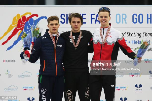 Chris Huizinga of Netherlands Allan Dahl Johansson of Norway and Tyson Langelaar of Canada pose in the Men's 1500m medal ceremony during day one of...