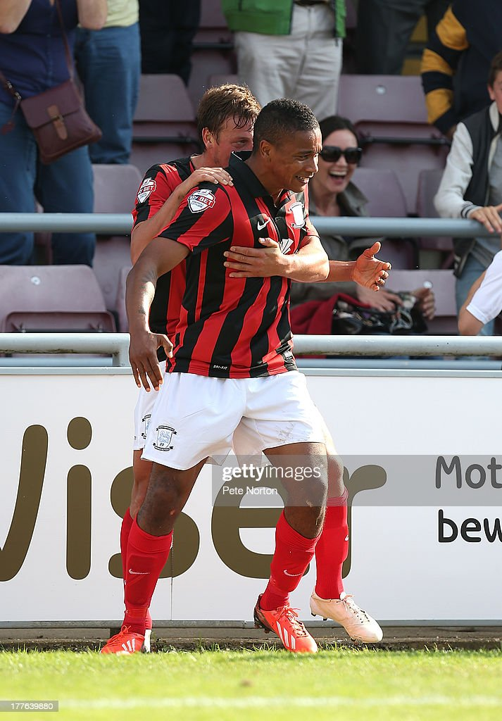 Chris Humphrey of Preston North End is celebrates with team mate Lee Holmes after scoring their fourth goal during the Sky Bet League One match between Coventry City and Preston North End at Sixfields Stadium on August 25, 2013 in Northampton, England.