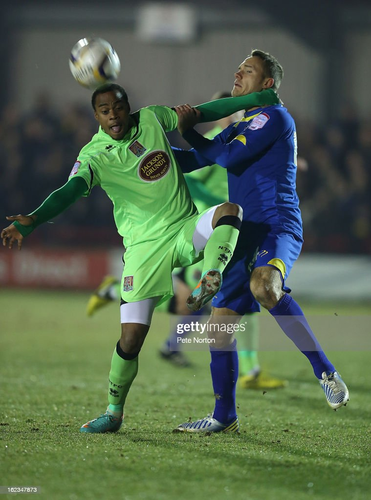 Chris Hussey of AFC Wimbledon (r) contests the ball with Ishmel Demontagnac of Northampton Town in action during the npower League Two match between AFC Wimbledon and Northampton Town at The Cherry Red Records Stadium on February 19, 2013 in Kingston upon Thames, England.
