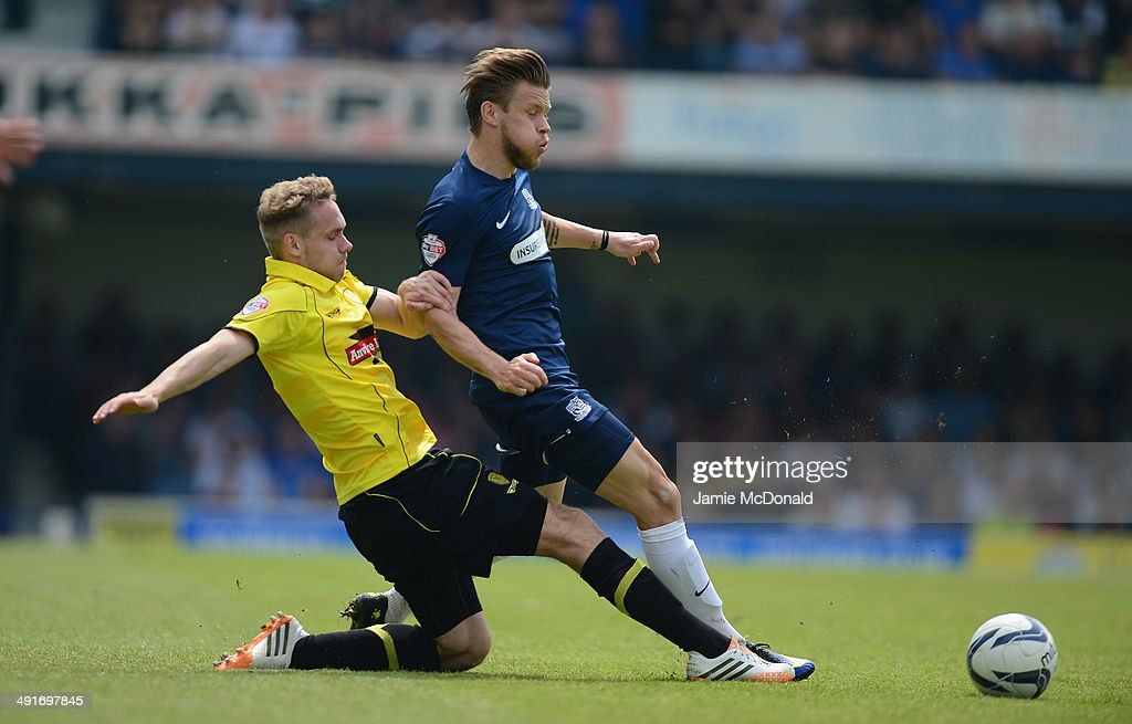 Chris Hussey of Burton Albion battles with Kevan Hurst of Southend United during the Sky Bet League Two semi-final, second leg match between Southend United and Burton Albion at Roots Hall on May 17, 2014 in Southend, England.