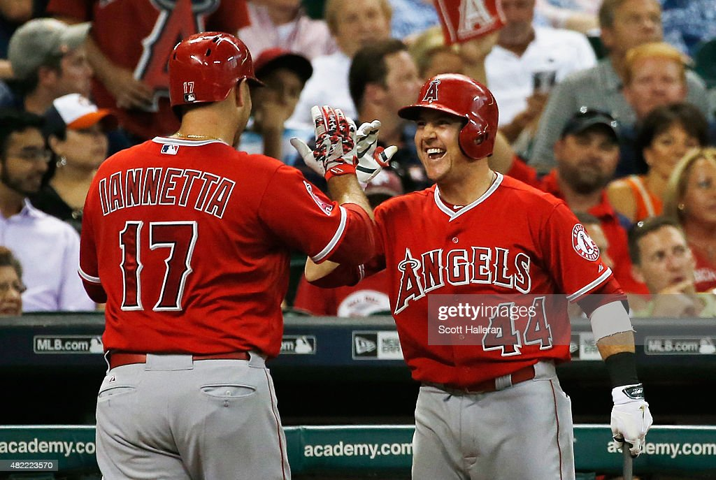 Chris Iannetta #17 and Daniel Robertson #44 of the Los Angeles Angels of Anaheim celebrate after Iannetta hit a solo home run in the third inning off Collin McHugh of the Houston Astros during their game at Minute Maid Park on July 28, 2015 in Houston, Texas.