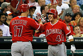 Chris Iannetta and Daniel Robertson of the Los Angeles Angels of Anaheim celebrate after Iannetta hit a solo home run in the third inning off Collin...