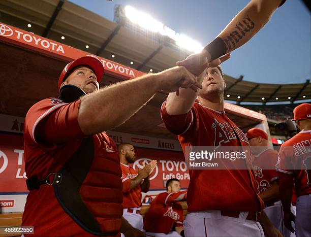 Chris Iannetta and David Freese of the Los Angeles Angels of Anaheim high five before the game against the Seattle Mariners on September 17 2014 at...