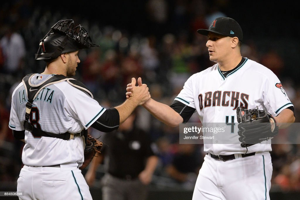 Chris Iannetta #8 and David Hernandez #47 of the Arizona Diamondbacks celebrate after closing out the game against the San Francisco Giants at Chase Field on September 26, 2017 in Phoenix, Arizona.