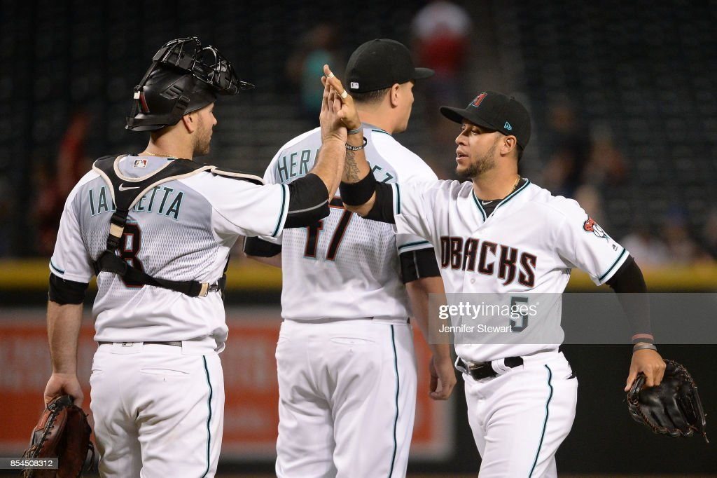 Chris Iannetta #8 and Gregor Blanco #5 of the Arizona Diamondbacks high five after closing out the MLB game against the San Francisco Giants at Chase Field on September 26, 2017 in Phoenix, Arizona.