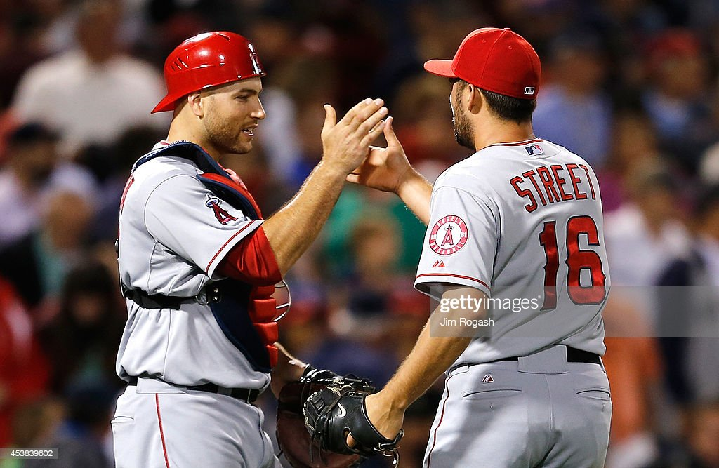 Chris Iannetta #17 and Huston Street #16 of the Los Angeles Angels of Anaheim celebrate a 4-3 win over the Boston Red Sox at Fenway Park on August 19, 2014 in Boston, Massachusetts.
