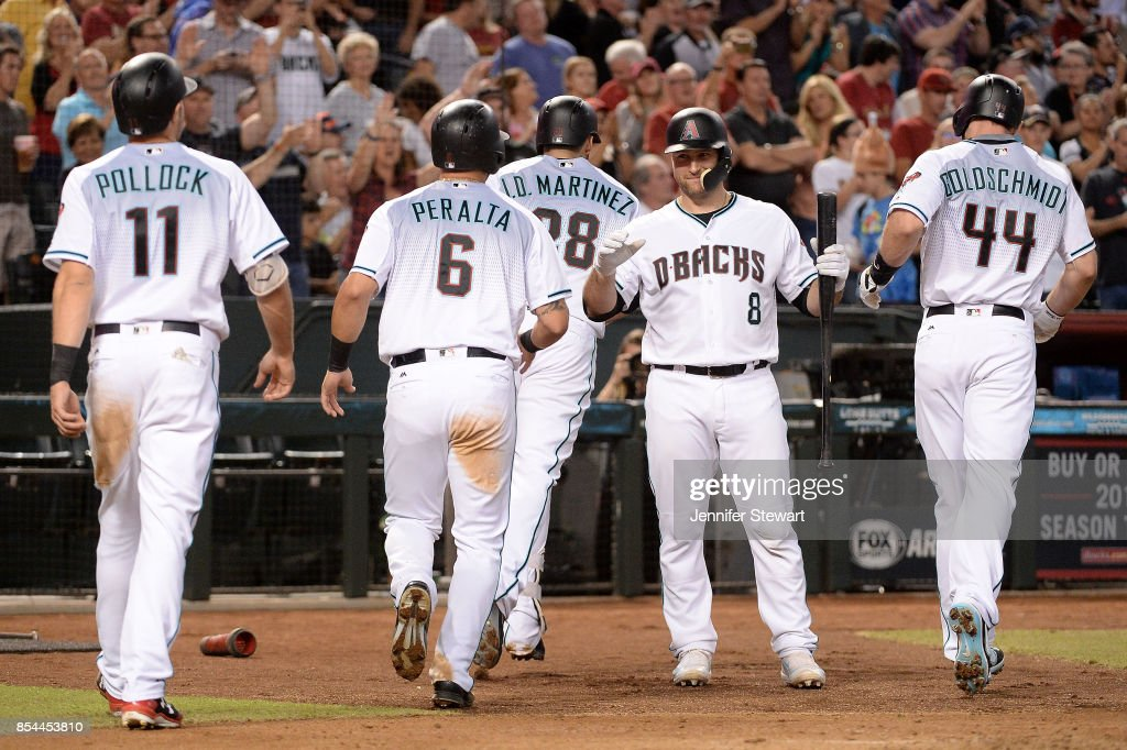 Chris Iannetta #8 of the Arizona Diamondbacks congratulates A.J. Pollock #11, David Peralta #6, J.D. Martinez #28 and Paul Goldschmidt #44 after Martinez hits a grand slam in the second inning of the MLB game against the San Francisco Giants at Chase Field on September 26, 2017 in Phoenix, Arizona.