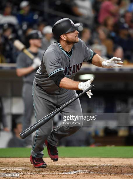 Chris Iannetta of the Arizona Diamondbacks hits a solo home run during the eighth inning of a baseball game against the San Diego Padres at PETCO...