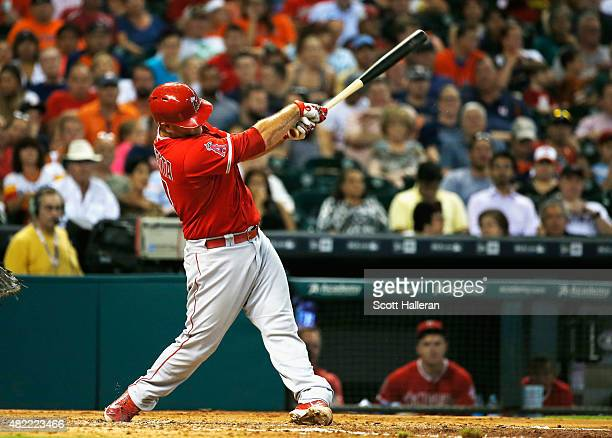Chris Iannetta of the Los Angeles Angels of Anaheim connects on a solo home run in the third inning during their game against the Houston Astros at...