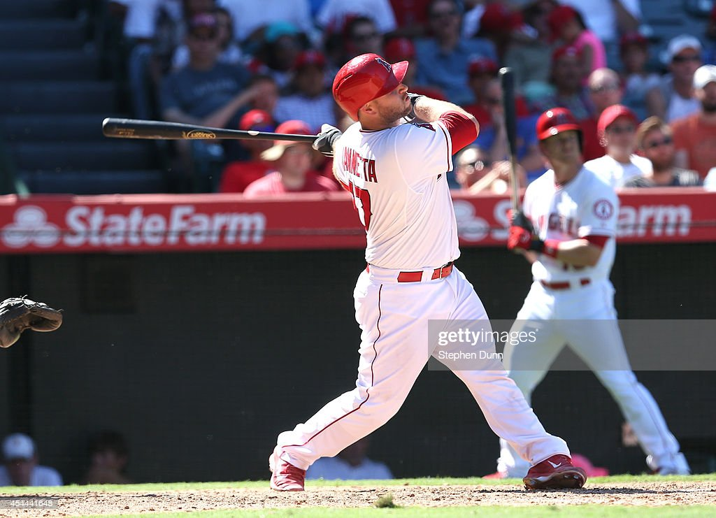 Chris Iannetta #17 of the Los Angeles Angels of Anaheim hits a solo home run in the eighth inning against the Oakland Athletics at Angel Stadium of Anaheim on August 31, 2014 in Anaheim, California. The Angels won 8-1 to complete a four game sweep.