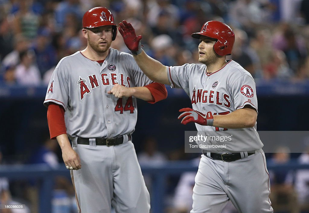 <a gi-track='captionPersonalityLinkClicked' href=/galleries/search?phrase=Chris+Iannetta&family=editorial&specificpeople=836137 ng-click='$event.stopPropagation()'>Chris Iannetta</a> #17 of the Los Angeles Angels of Anaheim is congratulated by <a gi-track='captionPersonalityLinkClicked' href=/galleries/search?phrase=Mark+Trumbo&family=editorial&specificpeople=4921667 ng-click='$event.stopPropagation()'>Mark Trumbo</a> #44 after hitting a two-run home run in the sixth inning during MLB game action against the Toronto Blue Jays on September 10, 2013 at Rogers Centre in Toronto, Ontario, Canada.