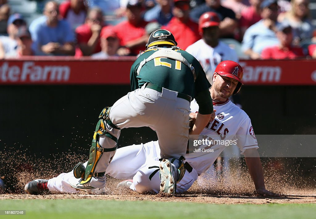 <a gi-track='captionPersonalityLinkClicked' href=/galleries/search?phrase=Chris+Iannetta&family=editorial&specificpeople=836137 ng-click='$event.stopPropagation()'>Chris Iannetta</a> #17 of the Los Angeles Angels of Anaheim is tagged out at home by catcher Stephen Vogt #21 of the Oakland Athletics in the fifth inning at Angel Stadium of Anaheim on September 25, 2013 in Anaheim, California.
