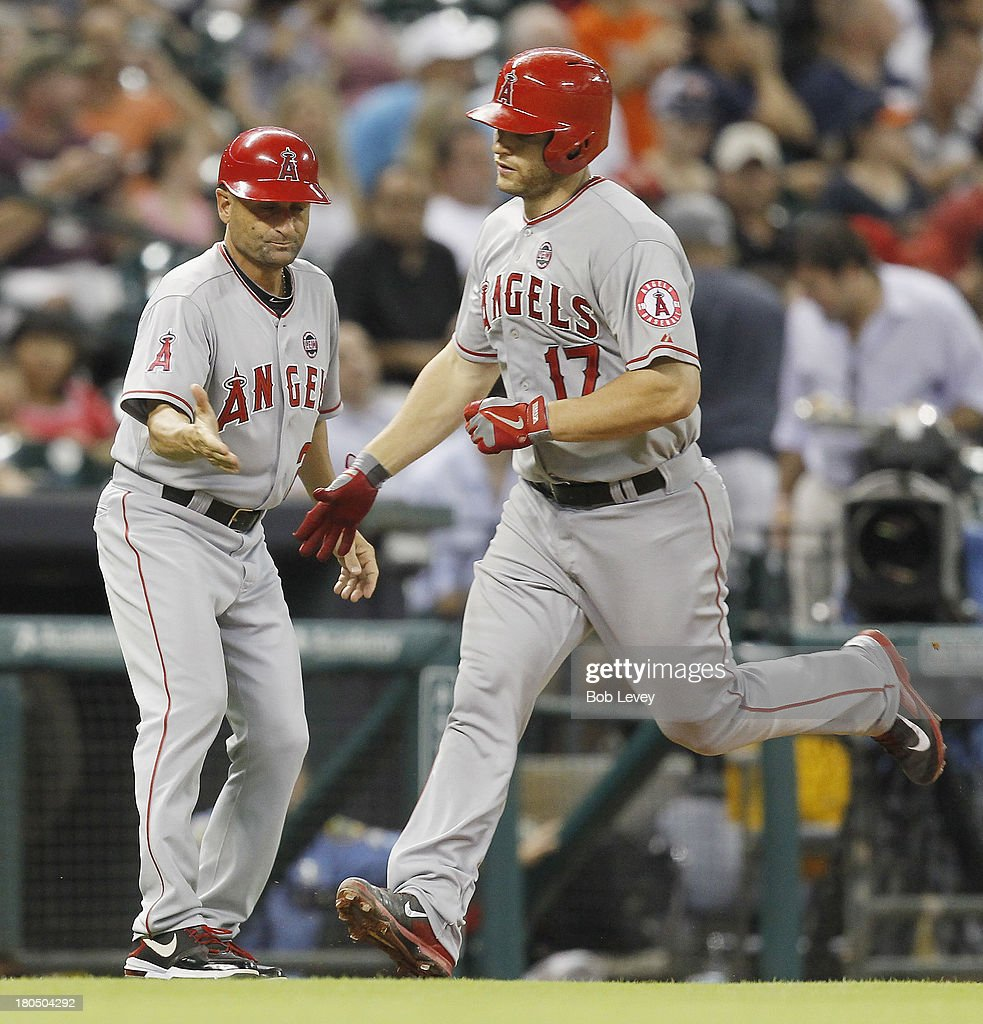 <a gi-track='captionPersonalityLinkClicked' href=/galleries/search?phrase=Chris+Iannetta&family=editorial&specificpeople=836137 ng-click='$event.stopPropagation()'>Chris Iannetta</a> #17 of the Los Angeles Angels of Anaheim receives congratulations from third base coach Dino Ebel #21 of the Los Angeles Angels of Anaheim after hitting a home run in the fourth inning against the Houston Astros at Minute Maid Park on September 13, 2013 in Houston, Texas.